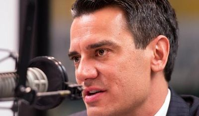 """Rep. Kevin Yoder, Kansas Republican, apologizes Aug. 20, 2012, to his constituents on the air during the """"Up To Date"""" radio show on KCUR-FM in Kansas City, Mo., after a published report revealed the freshman lawmaker swam nude in the Sea of Galilee during a private fact-finding trip to the Mideast last August. (Associated Press/The Kansas City Star)"""
