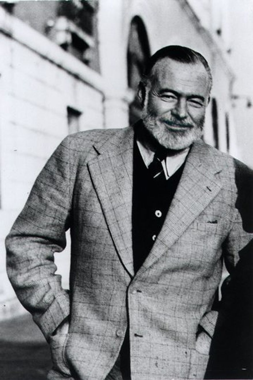 Ernest Hemingway stands on the Bridge of Sighs in Venice, Italy, in this 1950 photo taken by his friend Aaron Edward Hotchner. Unpublished material by Hemingway - stories, articles, photos, letters home movies, recordings and a longer version of his last bullfight book - is being given to the Library of Congress, a gift of his friend Hotchner. (AP Photo/Library of Congress, A.E. Hotchner)