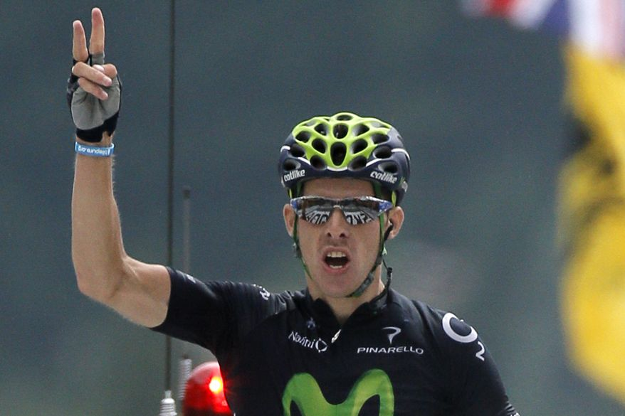 Rui Alberto Costa of Portugal crosses the finish line to win the nineteenth stage of the Tour de France cycling race over 204.5 kilometers (127.8 miles) with start in in Bourg-d'Oisans and finish in Le Grand-Bornand, France, Friday July 19 2013. (AP Photo/Laurent Rebours)