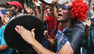 ** FILE ** Supporters of Egypt's ousted President Mohammed Morsi beats their drums as they shout slogans during a demonstration, where protesters have installed their camp and held their daily rally, at Nasr city, Cairo, Egypt, Friday, July 19, 2013. (AP Photo/Hussein Malla)