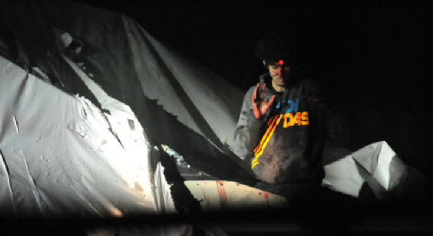 ** FILE ** A sniper targets Boston Marathon bombing suspect Dzhokhar Tsarnaev, who was hiding in a boat in a backyard in Watertown, Mass. (Screenshot of photo released by Sgt. Sean Murphy to Boston Magazine)