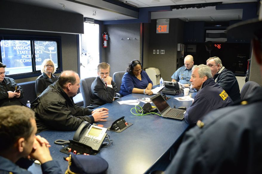 Federal, state and local law enforcement officials plan the hunt for Dzhokhar Tsarnaev in a Massachusetts State Police mobile command unit. (credit: Sgt. Sean Murphy)