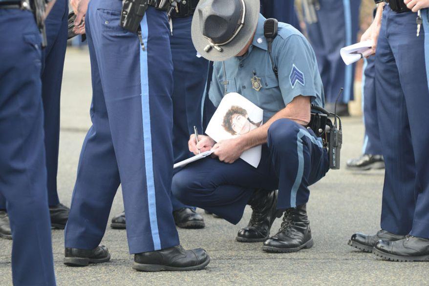 A Massachusetts State Police trooper in the hunt for Dzhokhar Tsarnaev. (credit Sgt. Sean Murphy)