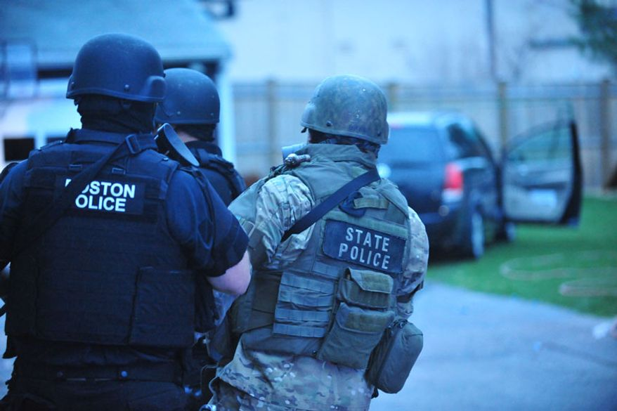 Police close in on Dzhokhar Tsarnaev. (credit: Sgt. Sean Murphy)
