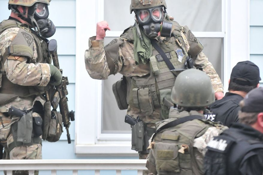 Police close in on Dzhokhar Tsarnaev. (credit Sgt. Sean Murphy)