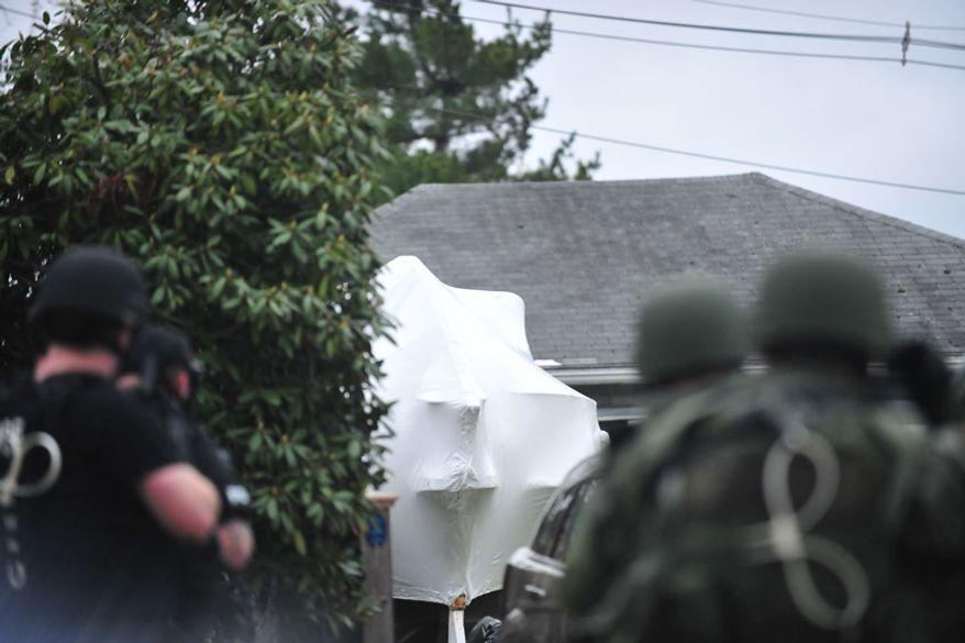 Police move in on Dzhokhar Tsarnaev boat hideout. (credit: Sgt. Sean Murphy)