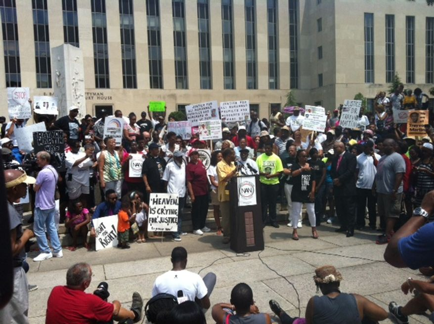 "Radio talk show host Joe Madison addresses a ""Justice for Trayvon"" rally outside the U.S. District Court for the District on Saturday (Andrea Noble/The Washington Times)"