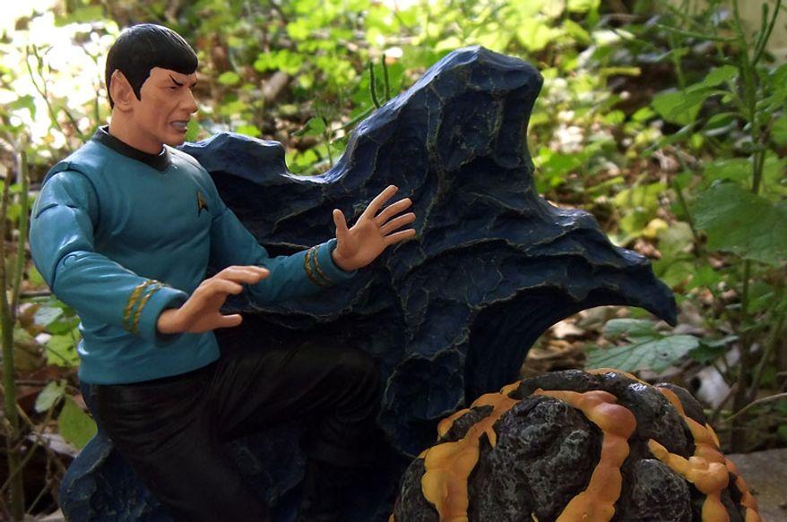 Diamond Select Toys' Mr. Spock performs a mind-meld to feel the pain of the Horta.  (Photo by Joseph Szadkowski / The Washington Times)