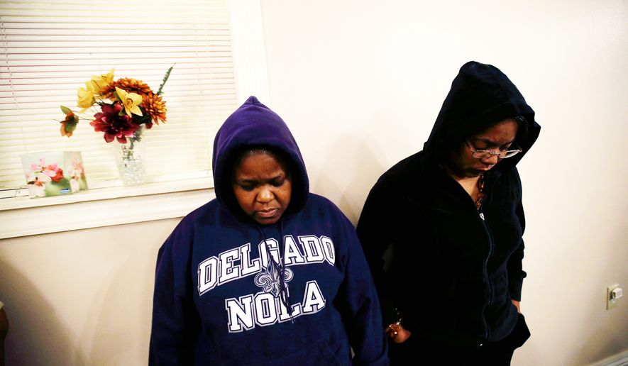 """Loretta Powell (left) and Tyra Forrest take part in a """"Hoodie Sabbath"""" at the New St. Mark Baptist Church in New Orleans in reaction to George Zimmerman's acquittal in the death of Trayvon Martin. Some black Americans, however, are calling for a cooling of tensions. (Associated Press) ** FILE **"""