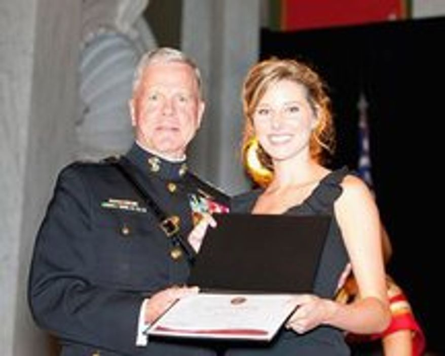Alison Spann receives a scholarship award from Gen. James F. Amos, commandant of the Marine Corps.