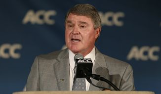 Atlantic Coast Conference commissioner John Swofford speaks to the media during the ACC Media Day in Greensboro, N.C., Sunday, July 21, 2013. (AP Photo/Chuck Burton)