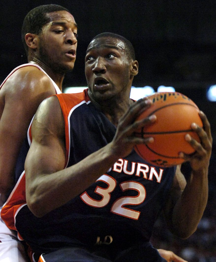 **FILE** Auburn's Korvotney Barber (32) looks toward the basket as Arkansas' Darian Townes, left, defends during the first half of a college basketball game in Fayetteville, Ark., Wednesday, Feb. 7, 2007. (AP Photo/April L. Brown)
