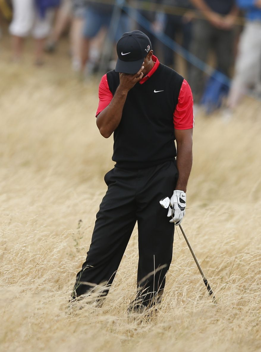 Tiger Woods of the United States reacts after playing a shot on the 11th hole during the final round of the British Open Golf Championship at Muirfield, Scotland, Sunday July 21, 2013. (AP Photo/Matt Dunham)