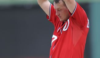 Washington Nationals starting pitcher Jordan Zimmermann pauses on the mound during the second inning of a baseball game against the Los Angeles Dodgers, Sunday, July 21, 2013, in Washington. (AP Photo/Nick Wass)
