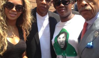 The recording artists Beyonce (from left) and Jay-Z join Trayvon Martin's mother, Sybrina Fulton, and the Rev. Al Sharpton at the Justice for Trayvon vigil in New York on Saturday, July 20, 2013. (AP Photo/Noerdlinger Media, Rachel Noerdlinger)