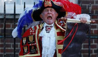 Town crier Tony Appleton announces the birth of a son to Prince William and wife Catherine. The infant will be third in line for the British throne. (Associated Press)