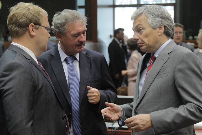 Foreign Ministers Didier Reynders (right) of Belgium, Jean Asselborn (center) of Luxembourg and Urmas Paet (left) of Estonia confer during a meeting of European Union foreign ministers in Brussels on Monday, July 22, 2013. The EU has designated Hezbollah's military wing a terrorist organization. (AP Photo/Yves Logghe)