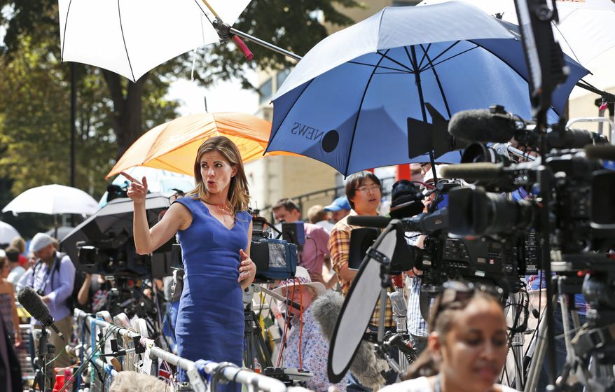 Broadcaster Natalie Morales, of NBC, broadcasts a live report, across from St. Mary's Hospital exclusive Lindo Wing in London, Monday, July 22, 2013. Buckingham Palace officials say Prince William's wife, Kate, has been admitted to the hospital in the early stages of labour. Royal officials said that Kate traveled by car to St. Mary's Hospital in central London. Kate _ also known as the Duchess of Cambridge _ is expected to give birth in the private Lindo Wing of the hospital, where Princess Diana gave birth to William and his younger brother, Prince Harry.The baby will be third in line for the British throne _ behind Prince Charles and William _ and is anticipated eventually to become king or queen. (AP Photo/Lefteris Pitarakis)