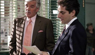 """** FILE ** In this undated photo from NBC Universal, Dennis Farina, who plays New York Police Detective Joe Fontana, acts in a scene with Michael Imperioli in the role of Detective Nick Falco, in an episode from NBC's police drama,""""Law & Order."""" Farina died suddenly on Monday, July 22, 2013, in Scottsdale, Ariz., after suffering a blood clot in his lung. He was 69. (AP Photo/ NBC Universal,Jessica Burstein)"""