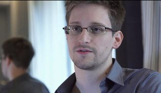 """The father of National Security Agency leaker Edward J. Snowden arrived Thursday, Oct. 11 in Moscow hoping to meet his son. """"I am his father. I love my son,"""" Lon Snowden told reporters in remarks broadcast by Russian TV. (Associated Press)"""
