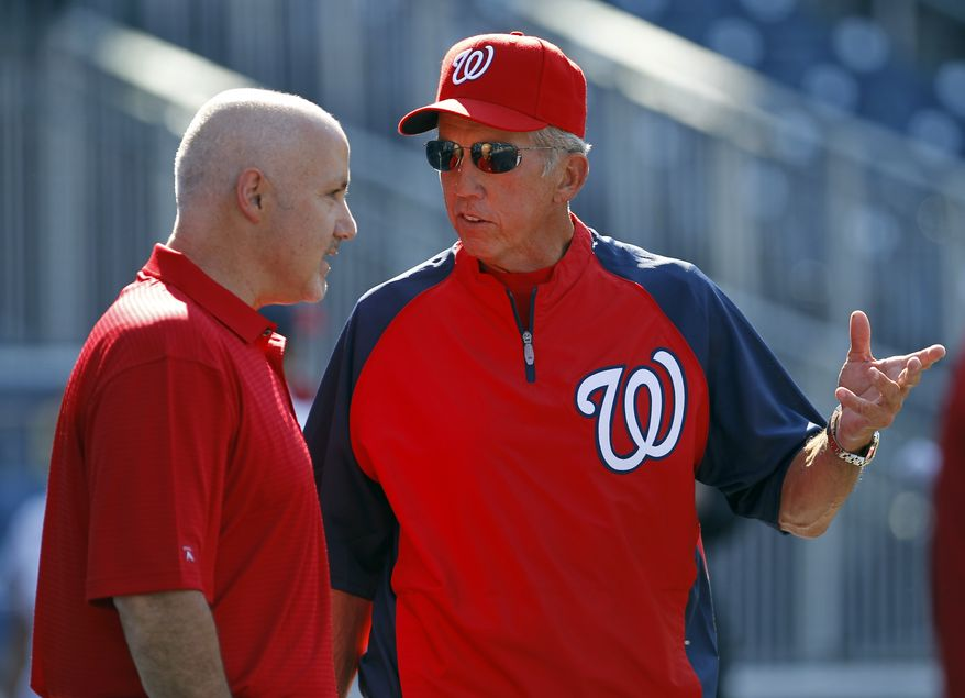**FILE** Washington Nationals manager Davey Johnson, right, talks with general manager Mike Rizzo, left, prior to a Nationals baseball game against the Pittsburgh Pirates in Washington, Friday, July 1, 2011. (AP Photo/Ann Heisenfelt)