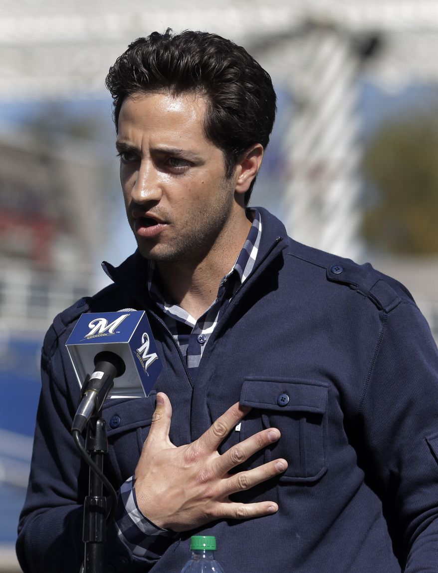 """FILE - In this Feb. 24, 2012 file photo, Milwaukee Brewers' Ryan Braun speaks during a news conference at spring training baseball in Phoenix. Braun stood on a spring training field and proclaimed he was innocent of using banned testosterone. """"I would bet my life,"""" he said back then, """"that this substance never entered my body at any point."""" Seventeen months later, he accepted a 65-game suspension from baseball and admitted, """"I am not perfect. The 2011 National League MVP was suspended without pay for the rest of the season and the postseason Monday, July 22, 2013, the start of sanctions involving players reportedly tied to a Florida clinic accused of distributing performance-enhancing drugs. (AP Photo/Jae C. Hong, File)"""