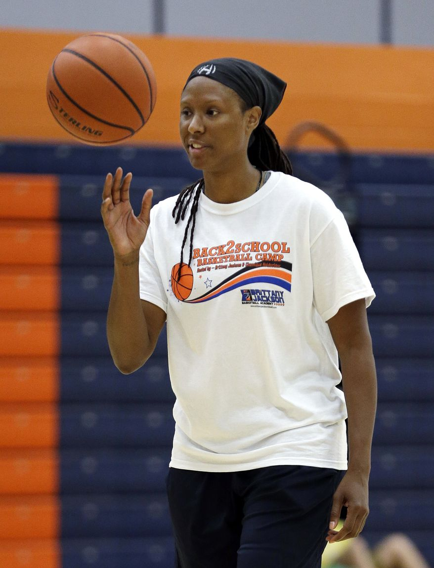 "Former WNBA star and Olympic gold medalist Chamique Holdsclaw takes part in a youth basketball clinic Tuesday, July 23, 2013, in Hendersonville, Tenn. Holdsclaw said she's getting her life back in order after a few months that felt like a ""mental prison"" after an arrest last November. (AP Photo/Mark Humphrey)"