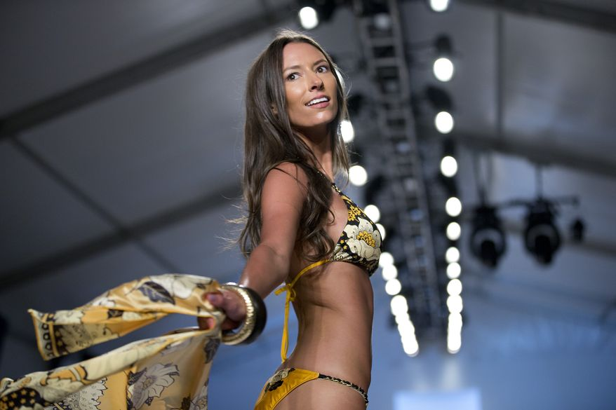 A model walks the runway during the Sauvage show at the Mercedes-Benz Fashion Week Swim show in Miami Beach, Fla., Monday, July 22, 2013. (AP Photo/J Pat Carter)