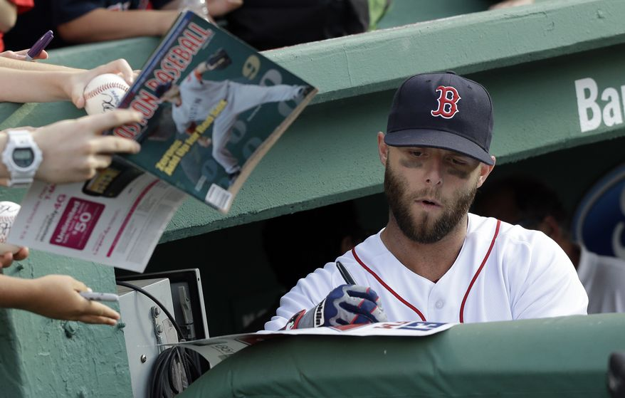 Boston Red Sox second baseman Dustin Pedroia signs for fans prior to an interleague baseball game against the San Diego Padres at Fenway Park in Boston, Tuesday, July 2, 2013. (AP Photo/Elise Amendola)