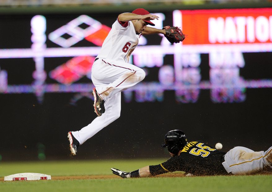 Washington Nationals second baseman Anthony Rendon jumps to avoid a Pittsburgh Pirates baserunner. (Associated Press photo)