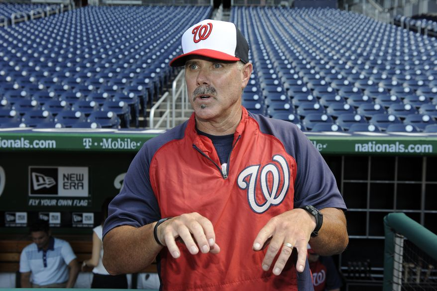 Washington Nationals new hitting coach Rick Schu talks with media members before a baseball game against the Pittsburgh Pirates, Tuesday, July 23, 2013, in Washington. (AP Photo/Nick Wass)