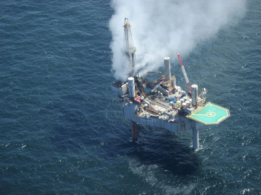 This photo released by the Bureau of Safety and Environmental Enforcement shows natural gas spewing from the Hercules 265 drilling rig in the Gulf of Mexico off the coast of Louisiana, Tuesday, July 23, 2013. (AP Photo/Bureau of Safety and Environmental Enforcement)