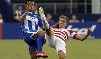 Honduras' Andy Najar (14) of D.C. United and United States' Stuart Holden (11) battle for control of the ball during the first half of the Gold Cup semifinals at Cowboys Stadium, Wednesday, July 24, 2013, in Arlington, Texas. (AP Photo/Brandon Wade)