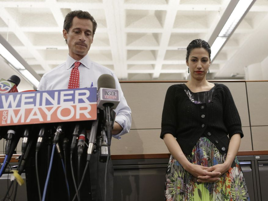 Then-New York mayoral candidate Anthony Weiner speaks during a news conference alongside his wife, Huma Abedin, at the Gay Men's Health Crisis headquarters in New York on July 23, 2013. (Associated Press) **FILE**