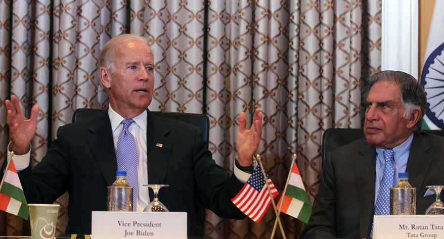 U.S. Vice President Joseph R. Biden (left) gestures as he speaks while Ratan Tata, former chairman of the Tata group, looks on during a meeting in Mumbai on Wednesday, July 24, 2013. Mr. Biden arrived in India on Monday on a trip that is focusing on boosting trade and regional security ties and strengthening a strategic partnership that has languished in recent years. (AP Photo/Rafiq Maqbool)