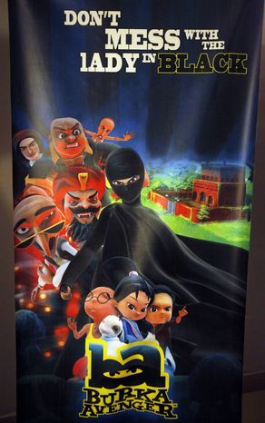 A poster of animated Burka Avenger series is displayed at an office in Islamabad, Pakistan, Wednesday, July 24, 2014.  Wonder Woman and Supergirl now have a Pakistani counterpart in the pantheon of female superheroes _ one who shows a lot less skin. Meet Burka Avenger: a mild-mannered teacher with secret martial arts skills who uses a flowing black burka to hide her identity as she fights local thugs seeking to shut down the girls' school where she works. Sadly, it's a battle Pakistanis are all too familiar with in the real world.(AP Photo/Anjum Naveed)