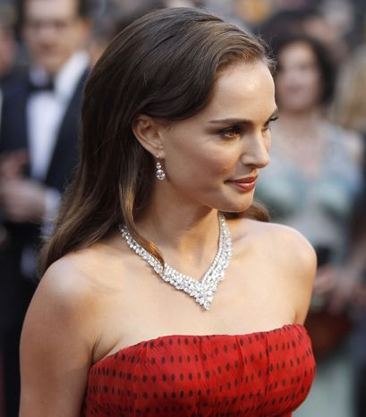 ** FILE ** In this Feb. 26, 2012, file photo, Natalie Portman arrives before the 84th Academy Awards in the Hollywood section of Los Angeles. A film official says Israeli-American actress Natalie Portman will direct her first feature film, based on the autobiography of celebrated Israeli author Amos Oz. (AP Photo/Chris Carlson. File)