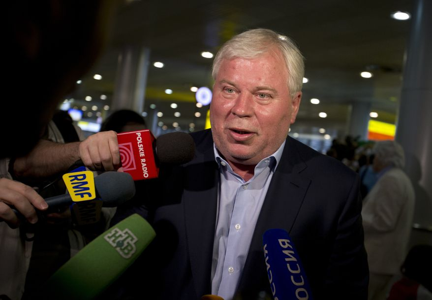 ** FILE ** Russian lawyer Anatoly Kucherena speaks to the media at Sheremetyevo Airport outside Moscow on Friday, July 12, 2013. (AP Photo/Alexander Zemlianichenko)