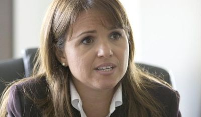 In this Oct. 1, 2010 file photo, Delaware Republican Senate candidate Christine O'Donnell gestures during an interview, in Wilmington, Del. (AP Photo/Rob Carr, File)