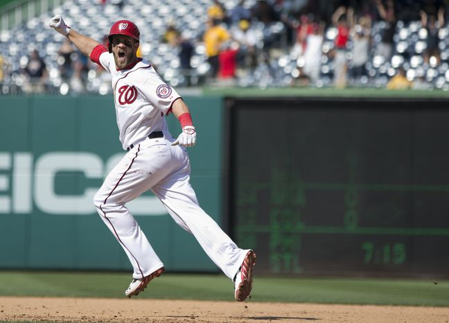 Washington Nationals outfielder Bryce Harper celebrates his first career walk-off home run, which gave the Nationals a 9-7 win over the Pirates on Thursday. (Associated Press photo)