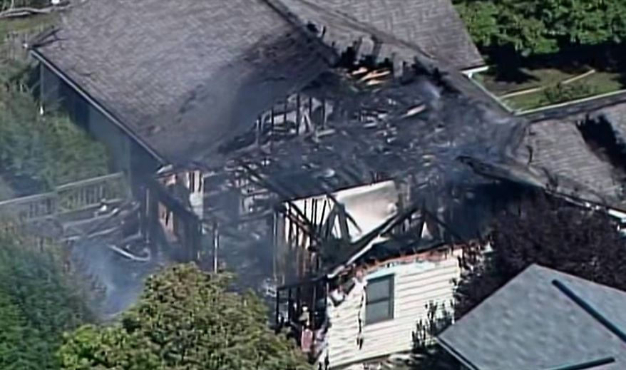 In this frame grab from video provided by Chopper 8, WISH TV, smoke rises from a house in Columbus, Ind., after a small plane crashed into the home. (AP Photo/Chopper 8, WISH TV)