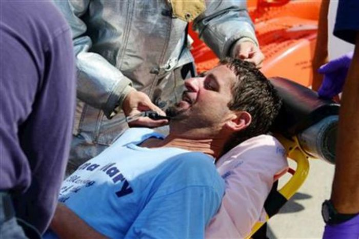 Lobsterman John Aldridge lies on a stretcher at Air Station Cape Cod in Sandwich, Mass., after being rescued by a Coast Guard helicopter, July 24, 2013. Aldridge, a fisherman for 19 years, fell overboard and spent 12 hours floating in the ocean south of Montauk, N.Y. before he was rescued. (AP Photo/US Coast Guard, Ross Ruddell)