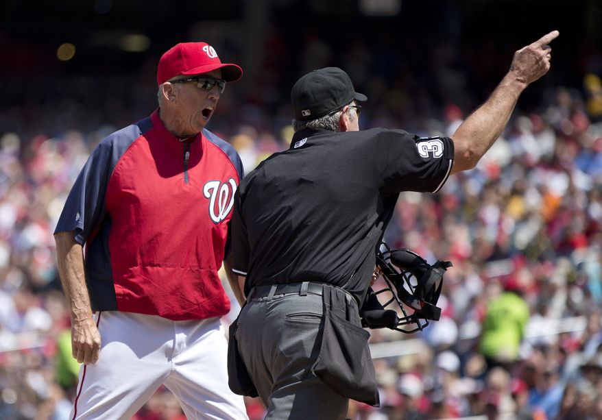 Washington Nationals manager Davey Johnson argues with home plate umpire Mike Winters as Winters ejects him from Thursday's game against the Pirates. (Associated Press photo)