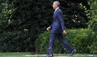 President Barack Obama walks from the Oval Office to Marine One on the South Lawn of the White House in Washington, Friday, July 26, 2013. Obama is spending the day at Camp David with members of his cabinet and their families. (AP Photo/Susan Walsh)