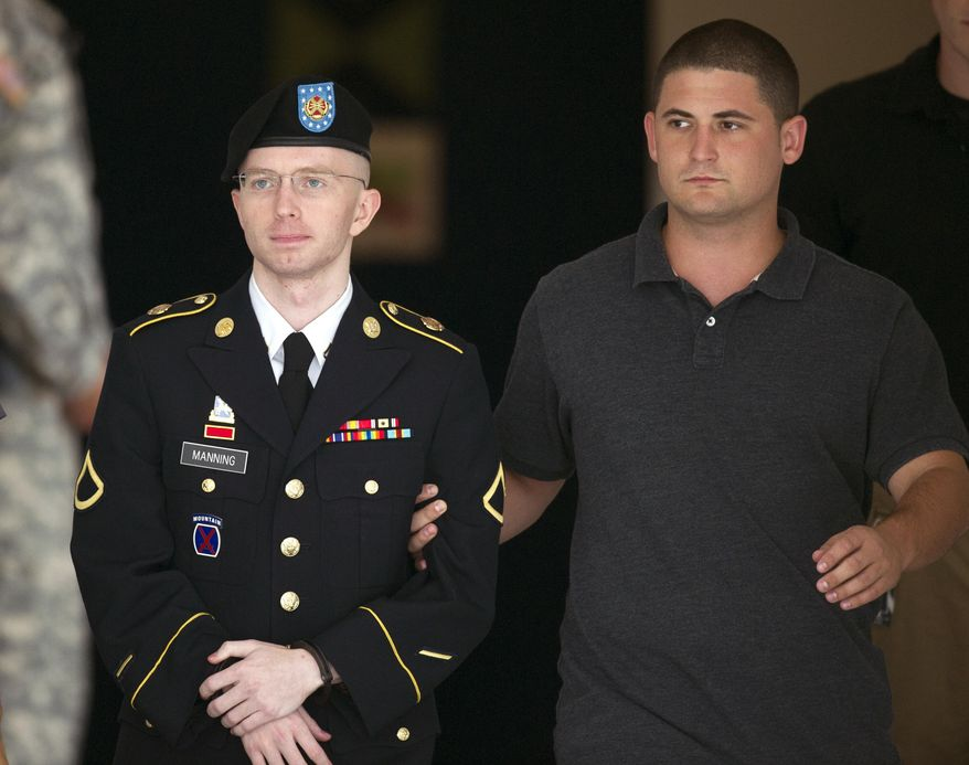 ** FILE ** Army Pfc. Bradley Manning is escorted out of a courthouse at Fort Meade, Md, Thursday, July 25, 2013. Pfc. Manning is charged with indirectly aiding the enemy by sending troves of classified material to WikiLeaks. He faces up to life in prison. (AP Photo/Cliff Owen)