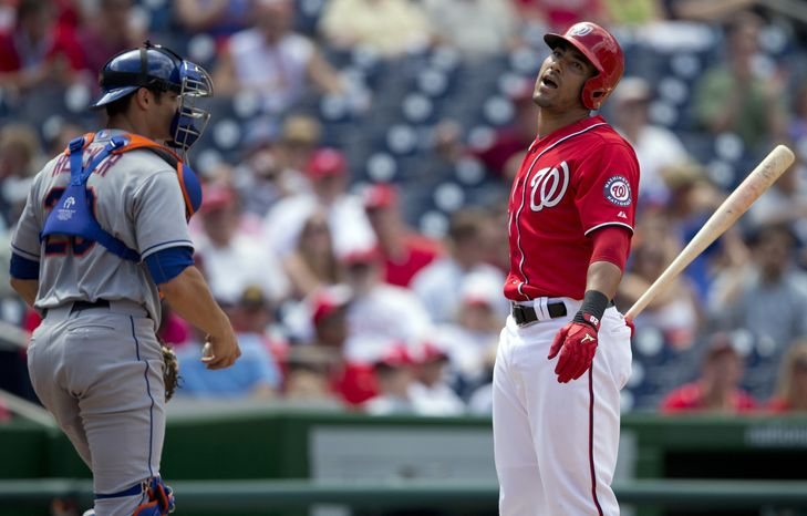 Washington Nationals shortstop reacts after striking out in the third inning of the Nationals' 11-0 loss to the New York Mets. (Associated Press photo)