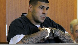 FILE - In this June 27, 2013, file photo, former New England Patriots NFL football tight end Aaron Hernandez stands during a bail hearing in Fall River Superior Court in Fall River, Mass. The legal problems of current and former SEC players _ from ex-Florida and NFL tight end Aaron Hernandez to LSU's Jeremy Hill _ has cast a negative light on the league that has won seven consecutive national championships. Coaches in the conference say they have to weigh a player's talent vs. trouble in or out of the locker room. (AP Photo/Boston Herald, Ted Fitzgerald, Pool, File)