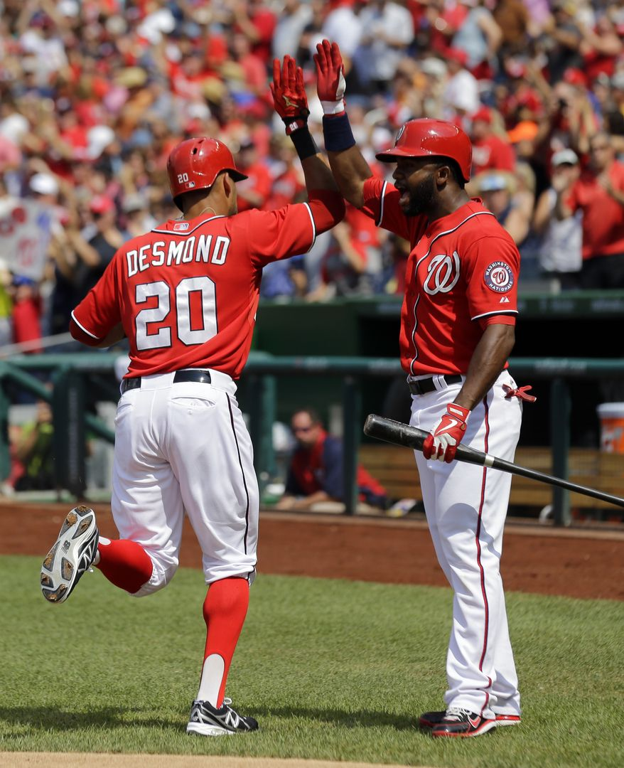 Washington Nationals shortstop Ian Desmond and center fielder Denard Span celebrate their back-to-back home runs in a win over the New York Mets. (Associated Press photo)