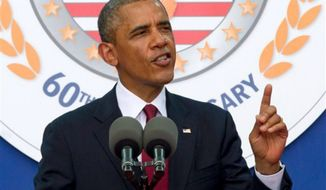 President Obama speaks on the 60th anniversary of the end of the Korean War, during remarks at a commemorative ceremony near the Korean War Veterans Memorial on the National Mall in Washington, on Saturday, July 27, 2013. (AP Photo/Jacquelyn Martin)