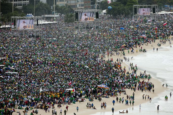 An estimated 3 million worshippers crowd the shore of Copacabana beach in Rio de Janeiro on Sunday, July 28, 2013, as Pope Francis celebrates the final Mass of World Youth Day. (AP Photo/Domenico Stinellis)